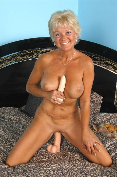 Tanned Granny Marcial Is Spreading Wide To Show Off Her