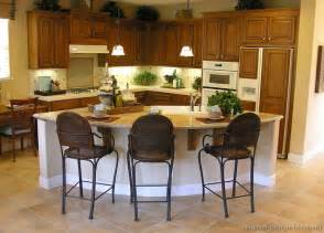 curved kitchen island pictures of kitchens traditional medium wood cabinets golden brown