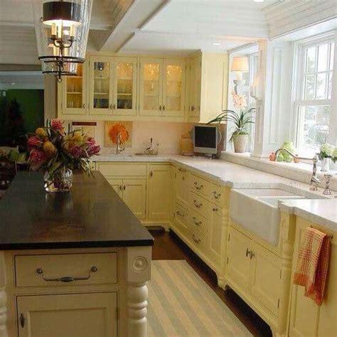 butter yellow kitchen cabinets 25 best ideas about yellow kitchen cabinets on 5005