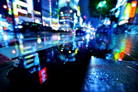 town japan tokyo shinjuku street rain wet pools water