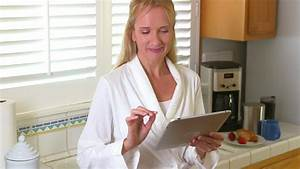 mature woman using tablet pc in bath robe stock footage With mature robe