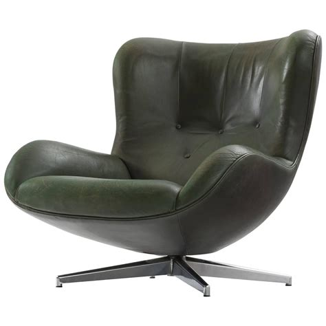 illum wikkels 248 green leather swivel lounge chair for sale