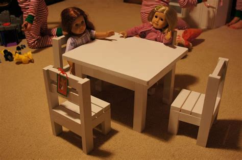 white claras table and 4 stackable chairs sized for