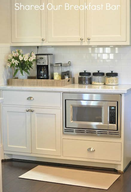 pictures of kitchens with white cabinets and black countertops i that the microwave is built in they take up so 9945