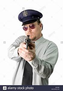 A police officer with his gun drawn isolated on white ...