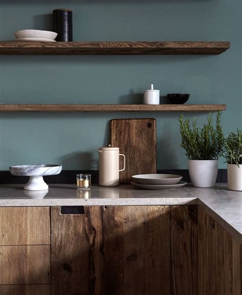 mid tone natural cabinets floating shelves blue green paint color modern rustic