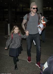 David Beckham holds five-year-old daughter Harper's doll ...