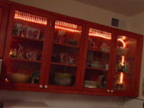 installing lights kitchen cabinets installing kitchen cabinet lights hgtv 7554