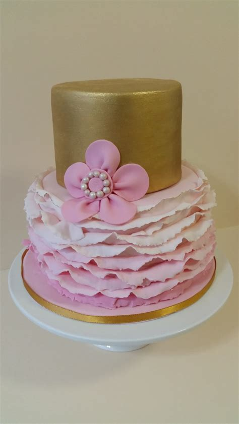 gold and pink birthday cake smooth gold top tier with