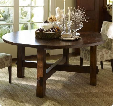 This large diy farmhouse table seats 8+ and adds gorgeous rustic charm to your home for less than $100. diy round outdoor dining table   Go to Imperfectly Polished for Jessie and Mike?s detailed ...