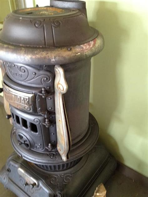 oak parlor stove antique  oak cast iron