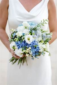 Country style bouquet consiting of blue delphinium and ...