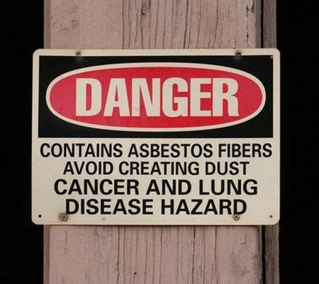 company fined   improper removal  asbestos