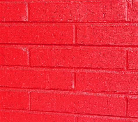 bricks painted bright red background image wallpaper