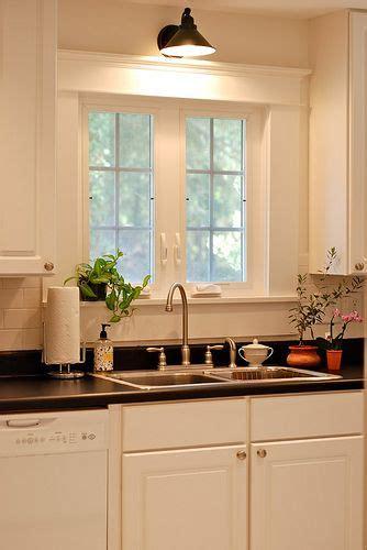 light above kitchen window floor remodel