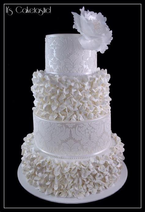 white  pearl wedding cake  ruffled flowers