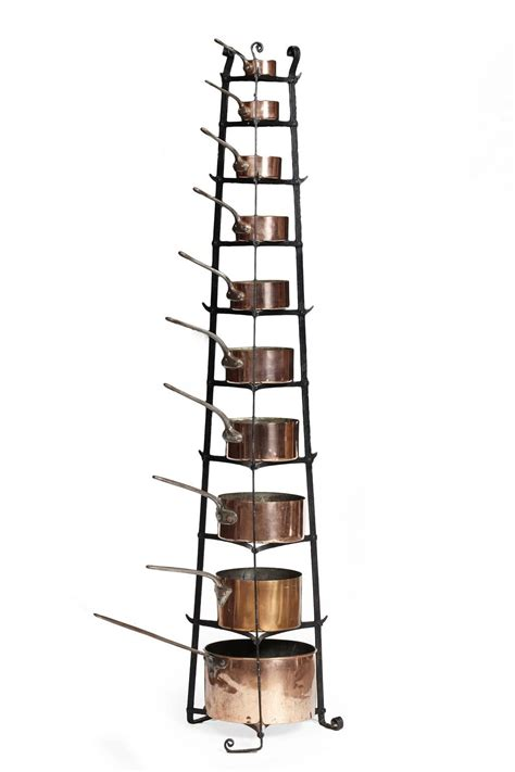assembled set  edwardian copper pans  wrought iron stand early  century stand cm high