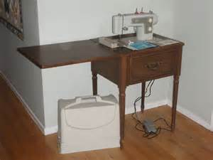 reduced old sears kenmore sewing machine with wooden