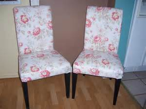 pair of ikea henriksdal parsons chairs with floral covers