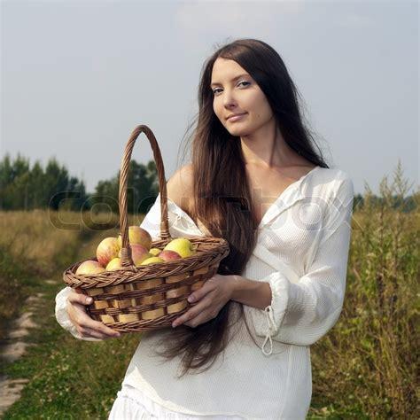 beautiful woman   meadow  basket  apples
