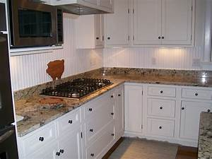 white wooden Beadboard Kitchen Cabinets with brown granite