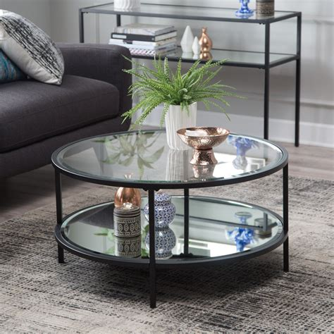 Round coffee tables have that sense of style and elegance that you don't acquire from other pieces of furniture. Contemporary Glam Metal Glass Modern Round Black Coffee Table w/ Shelf Furniture - Tables