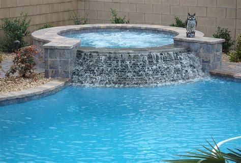 custom pool  raised spa  stacked stone spillway