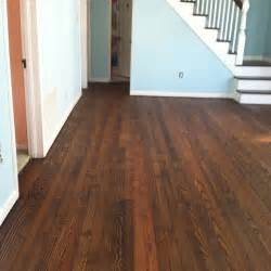carrie is in with hardwood floors with stained with minwax wood finish in walnut