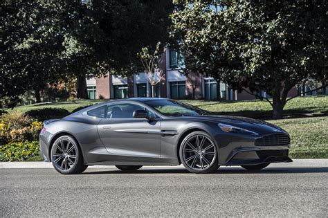 aston martin vanquish review ratings specs prices