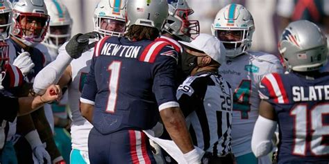 Cam Newton gets into kerfuffle with Dolphins players after ...