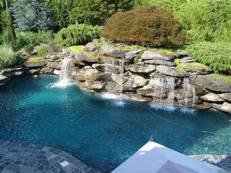 swimming pool landscape natural swimming pool landscaping with exotic look showing stone waterfall plus greenery