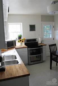 Best 25 metal kitchen cabinets ideas on pinterest for Best brand of paint for kitchen cabinets with papier peint retro