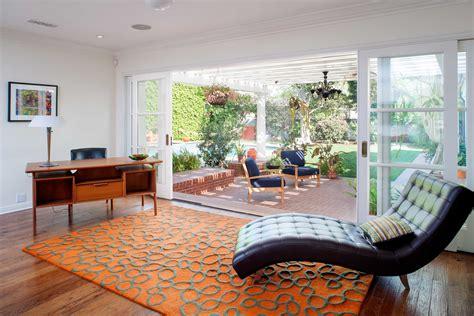 Modern Indoor Outdoor Living Room With Sliding Glass Doors