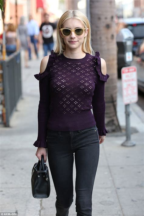 Emma Roberts makes a statement in purple open knit sweater ...