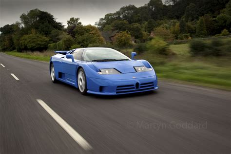 This was their first appearance in 55 years. Bugatti EB110 SS driving at speed on a country road in Hampshire UK - Martyn Goddard Images