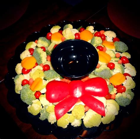 It has a rich pastry and strong, roasted vegetable aroma with a sour cheese note. Vegetable tray bouquet for Christmas dinner! The bow is made of red peppers. #vegetables # ...