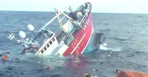 Boat Sinking Load Of Fish by Dramatic Footage Shows Five Fishermen Being Plucked From