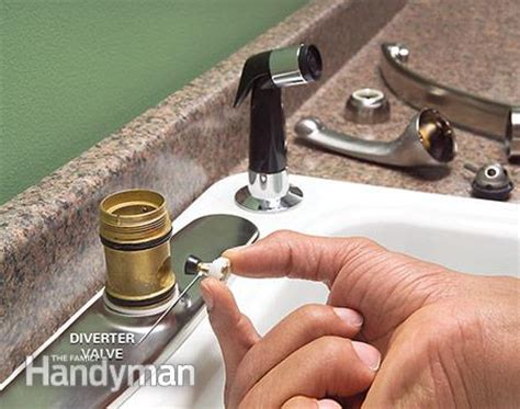 replace sink sprayer diverter how to fix a leaking sink sprayer the family handyman