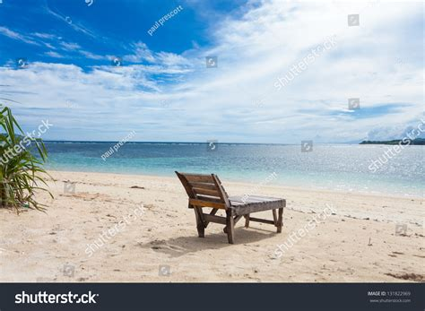Wooden Lounger On Lonely Beach Tropics Stock Photo