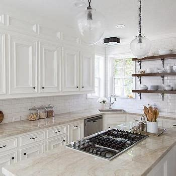 Taj Mahal Quartzite Countertops with White Kitchen