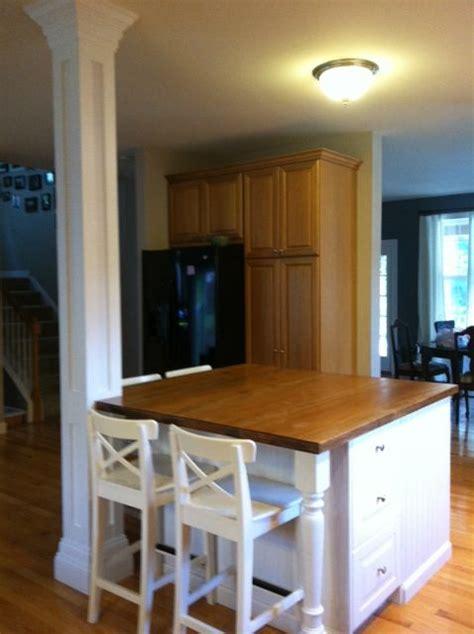 kitchen island with posts beautiful white kitchen island to contrast hardwood floors