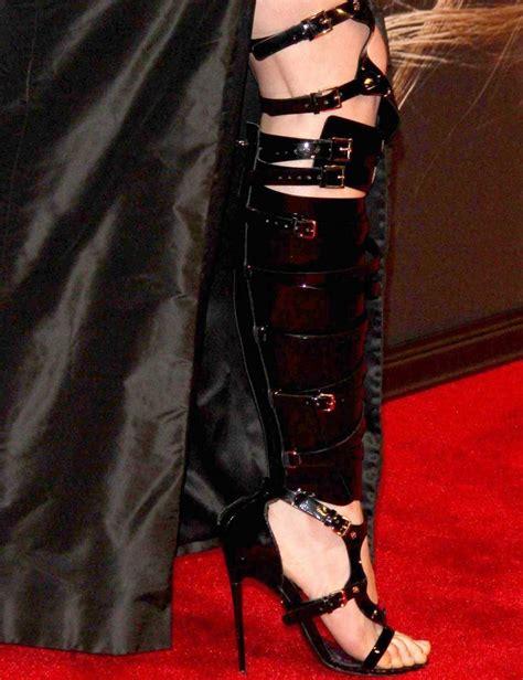 anna hathaway wears bespoke tom ford bondage boots  les