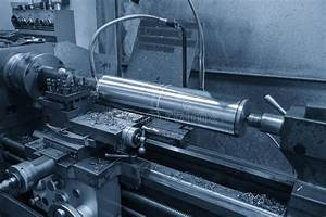 The Lathe Machine Cutting The Steel Rod Stock Image