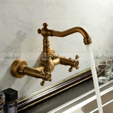 antique inspired kitchen faucet wall mount antique brass
