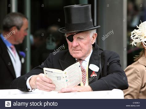 reading racing form man in top hat and eye patch reading a racing form ascot