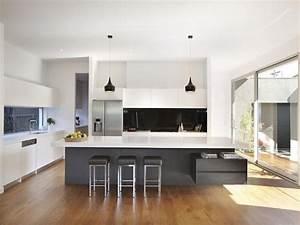 Modern island kitchen design using floorboards