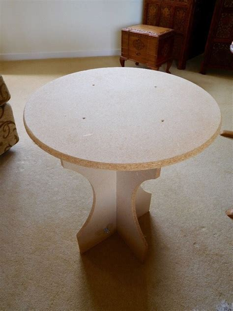small circular chipboard display table   table cloths