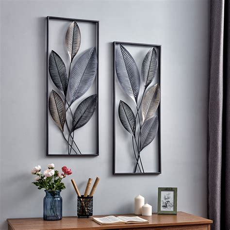 Layered pieces create a realistic feather look on these angelic accents. 20 Inspirations of Contemporary Iron Leaves Wall Decor By Winston Porter