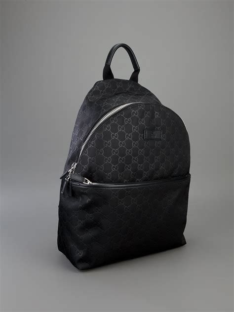 lyst gucci embossed monogram backpack  black
