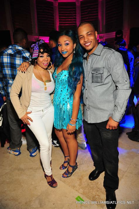 Zonnique with her parents T.I. and Tiny